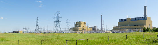 Coal burning power station in green landscape Royalty Free Stock Images