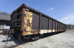 Coal Car. Abandoned railroad coal car in freight yard under blue sky Stock Photography