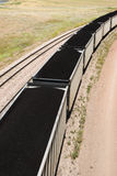 Coal cars. Rail cars loaded with coal being transported from nearby mines to power plants in Wyoming Royalty Free Stock Images