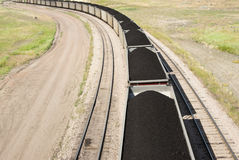 Coal cars. Rail cars loaded with coal being transported from nearby mines to power plants in Wyoming Stock Image