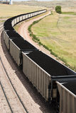 Coal cars. Rail cars loaded with coal being transported from nearby mines to power plants in Wyoming Royalty Free Stock Photography