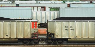 Coal Cars. Rail Road cars filled with coal in front of railcars waiting to leave staging area Stock Photo