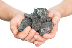 Coal coke in hand on white background Royalty Free Stock Photo