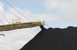 Coal conveyor machinery stacking the coal in piles Royalty Free Stock Photo
