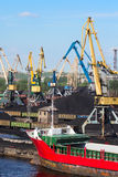 Coal cranes in port Royalty Free Stock Image