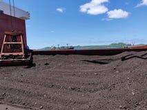 Coal discharging on bulk ship.  stock images