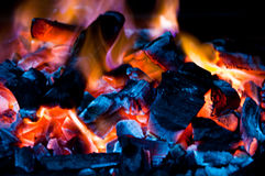 Coal Fire. Flaming Charcoal with a Black Background Royalty Free Stock Photography
