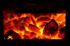 Coal fire. Coal burning in a steam train boiler furnace Stock Photos