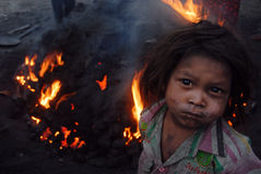 Coal Fire. January 29,2013 Jharia,Jharkhand,India,Asia-A portrait of the little coal piker in a coalmines area of Jharia Stock Image