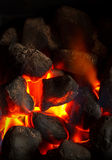 Coal fire glowing. Cose up of an imitation solid fuel fire powered by mains gas supply Stock Photo