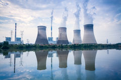 Coal-fired power plant. Cooling towers and river surface reflection , jiangxi , China Stock Photography