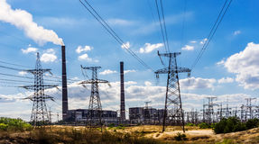 Coal-fired power plant and transmission lines in the foreground. Royalty Free Stock Photography