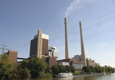 Coal fired power station. With new coal delivered on a barge -- global warming royalty free stock image