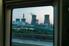 A coal-fired power station in the window of high-speed train from Shanghai to Wuxi, China Stock Images