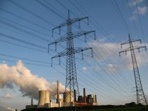 Coal-fired powerstation. With electricity pylons beside them Stock Image