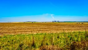 Coal fired powerstation in the middle of the wide open farmland, along the R39 in the Vaal River region of southern Mpumalanga. Province in South Africa Stock Images