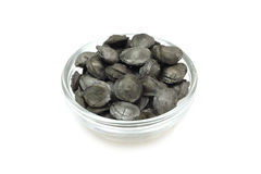 Coal from the fruit seeds in a glass bowl Royalty Free Stock Images