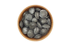 Coal from the fruit seeds in a wooden bowl Stock Photography