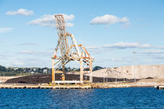 Coal and Gravel by Crane Royalty Free Stock Images