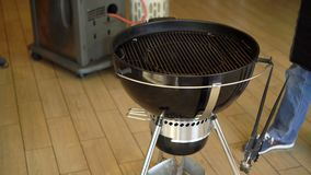Coal grill indoors stock video