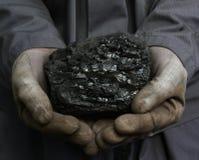 Coal in hands Stock Photos