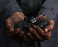 Coal in hands. Coal in the hands of a miner Stock Photo