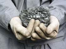 Coal in the hands Royalty Free Stock Image