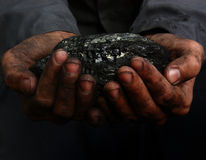 Coal in the hands Stock Images