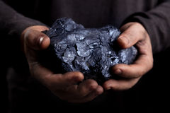 Coal. In the hands of the working royalty free stock photography