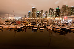 Coal Harbor and boats Vancouver. City, British Colombia, Canada Downtown Skyline taken at Night Stock Photo