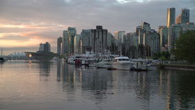 Coal Harbor Skyline, Vancouver. 4K UHD. Vancouver's city center and Coal Harbor at sunrise. Rowing team practice. British Columbia, Canada. 4K. UHD stock footage