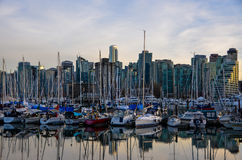 Coal Harbor, Vancouver. Vancouver's skyline with Coal Harbor's boats reflecting in the water Royalty Free Stock Images