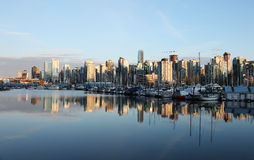 Coal Harbor, Vancouver at sunset. The city of Vancouver, British Columbia reflecting in the water at Coal Harbor, during sunset Stock Images