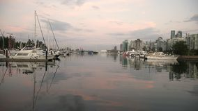 Coal Harbour Marinas and Skyline 4K UHD. The Vancouver skyline and marinas at dusk in Coal Harbour. British Columbia, Canada. 4K UHD stock video