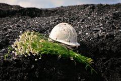 Coal and helmet Royalty Free Stock Photo