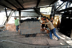 Coal India Worker. Indian workers busy in the coalmines Stock Photo