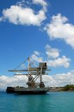 Coal Loader. Ship loading coal in the Philippines for power plant Stock Photo