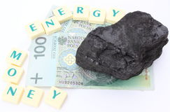 Coal lump with money on white background Stock Photos