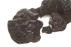 Coal lumps carbon nugget isolated on white. Power and energy source Stock Photos
