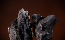 Coal lumps on dark background. Close-up Stock Images