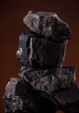 Coal lumps on dark background. Close-up Royalty Free Stock Photography