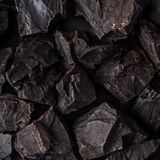 Coal lumps on dark background Stock Images