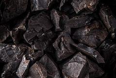 Coal lumps on dark background Royalty Free Stock Image