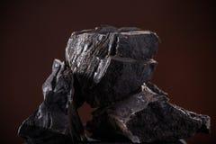 Coal lumps on dark background Stock Image