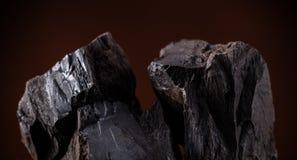 Coal lumps on dark background. Close-up Stock Image