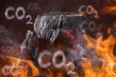 Coal lumps on dark background. Coal lumps with fire flames on dark background Stock Images