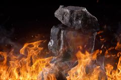 Coal lumps with fire flames Stock Photography
