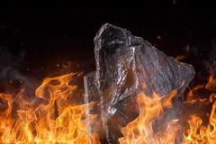 Coal lumps with fire flames Royalty Free Stock Photos