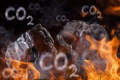 Coal lumps with fire flames Royalty Free Stock Photography