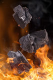 Coal lumps with fire flames Stock Photo